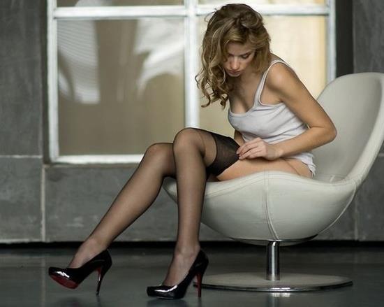 sexy woman putting stocking on