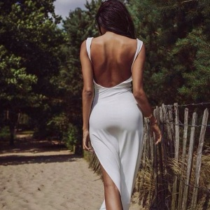 escort marbella white dress beach