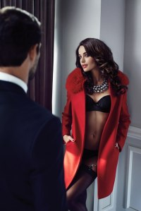 escort arriving at clients door wearing lingerie and a coat