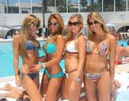 four girls in bikini at pool party in marbella