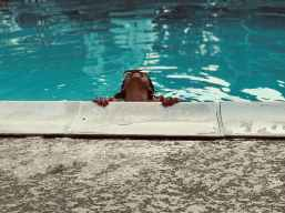 person inside swimming pool looking up